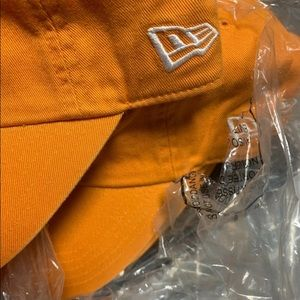 Brand New!! New Era fitted caps in orange/purple.